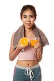 Asian healthy girl with orange and orange juice Stock Photo