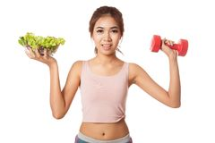 Asian healthy girl with salad bowl and dumbbell Royalty Free Stock Photo