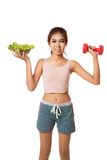 Asian healthy girl with salad bowl and dumbbell Royalty Free Stock Photography
