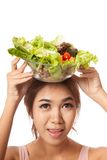 Asian healthy girl with salad bowl over head Royalty Free Stock Images