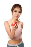 Asian healthy girl smile with red apple Stock Photos