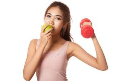 Asian healthy girl workout with dumbbell eat apple. Isolated on white background Stock Photo