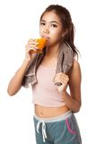 Asian healthy workout girl drinking orange  juice Royalty Free Stock Photos