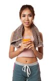 Asian healthy workout girl drinking orange  juice Royalty Free Stock Image