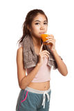 Asian healthy workout girl drinking orange  juice Royalty Free Stock Images