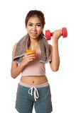 Asian healthy workout girl drinking orange  juice lift dumbbel Stock Photography