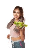 Asian healthy workout girl with measuring tape and salad Royalty Free Stock Images