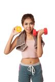 Asian healthy workout girl with orange and dumbbell Royalty Free Stock Photography