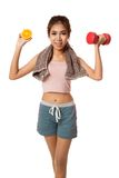 Asian healthy workout girl with orange and dumbbell Royalty Free Stock Image