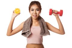 Asian healthy workout girl with orange and dumbbell Royalty Free Stock Photo