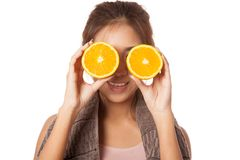 Asian healthy workout girl put orange over her eyes Stock Images