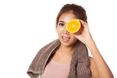Asian healthy workout girl put orange over her eyes Stock Photo