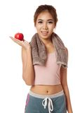 Asian healthy workout girl show red apple on her palm hand Stock Photo
