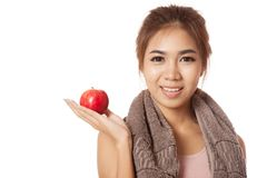 Asian healthy workout girl show red apple on her palm hand Royalty Free Stock Photography