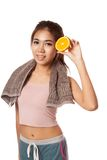Asian healthy workout girl smile show orange Royalty Free Stock Image