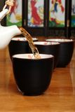 Asian Herb Tea Being Poured Royalty Free Stock Images