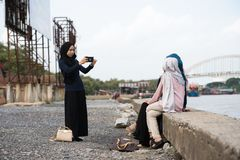 Asian hijab girl taking photo stock images