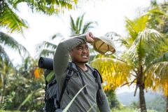 Asian hiker wipe his forehead. Portrait of asian hiker wipe his forehead Royalty Free Stock Images