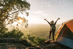 Asian Hiker woman standing near camping tent in carpathian mount stock photos