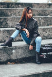 Asian hipster girl with fashionable brown leather jacket. Girl in leather jacket, cool fashion style Royalty Free Stock Photography