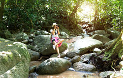 Asian hipster women take a photo of waterfall in deep forest in Thailand Stock Photography