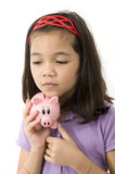 Asian Holding Piggy Bank Royalty Free Stock Photos