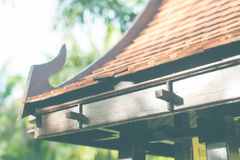 Asian House Arbour Buddhism Building Background. Tile Roof of Asian Arbour in a Garden Buddhism Building Summer Background Toned Royalty Free Stock Image
