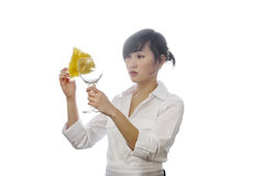 Asian house cleaner cleaning glass with backlit over white background Royalty Free Stock Images