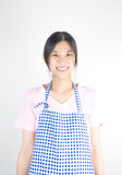 Asian house keeping maid with apron isolated Royalty Free Stock Image