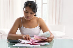 Asian housewife checking all the bills Stock Photos