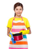 Asian housewife cleaning of saucepan Stock Images