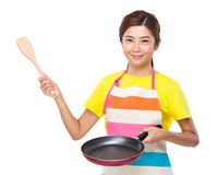 Asian housewife cooking with pan and spatula Royalty Free Stock Photos