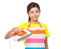 Asian housewife hold iron Royalty Free Stock Photo