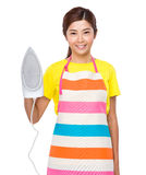 Asian housewife hold of iron Royalty Free Stock Image