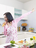 Asian housewife in kitchen Stock Photos