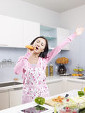 Asian housewife in kitchen Royalty Free Stock Photos