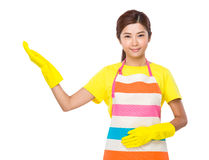 Asian housewife with open hand palm Royalty Free Stock Images