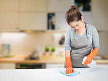Asian housewife sweeping on table Royalty Free Stock Images