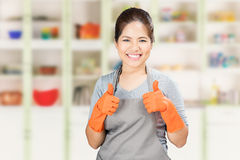 Asian housewife thumbs up Stock Photography