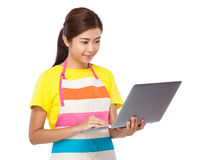 Asian housewife use of laptop computer Stock Photo