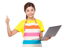 Asian housewife use of laptop computer and thumb up Stock Photos