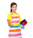 Asian Housewife wash saucepan Stock Images