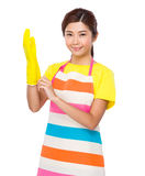 Asian housewife wear with the plastic gloves Royalty Free Stock Photo