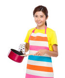 Asian houswife cooking with saucepan Stock Photography