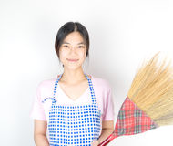 Asian houswife maid is holding broom Royalty Free Stock Photo