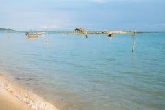 Asian idyllic coastal scene with traditional long tail fishing b Stock Photo