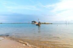 Asian idyllic coastal scene with traditional long tail fishing b Royalty Free Stock Image