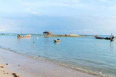 Asian idyllic coastal scene with traditional long tail fishing b Stock Image