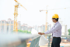 Asian Indian architect at construction site Royalty Free Stock Photos