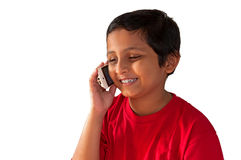 Asian,Indian, Bengali boy talking mobile,smiling. Asian, Indian, Bengali young boy talking on mobile phone, smiling, isolated,white background Stock Photography